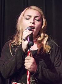 Jordan-Singing-Onstage-min